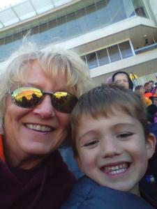 My mom with Superhero Son at the game