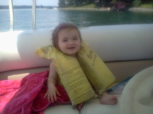 Darling Daughter's first boat ride.  Yes, her vest is inside out!