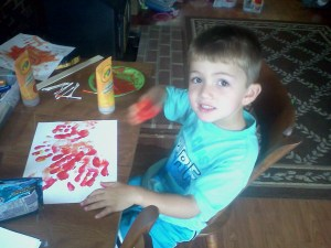 Superhero Son loves his fingerpaints.