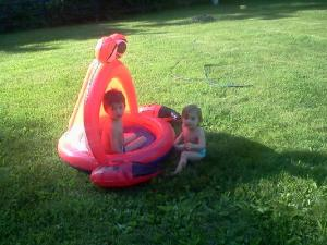 I caught the kids off-guard with the photo.  They love their pool and sprinkler and didn't want to be disturbed.