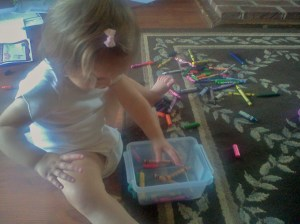New favorite game....dump the crayons out, then pick them up.